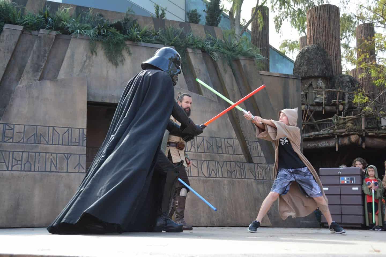 boy battling Darth vader