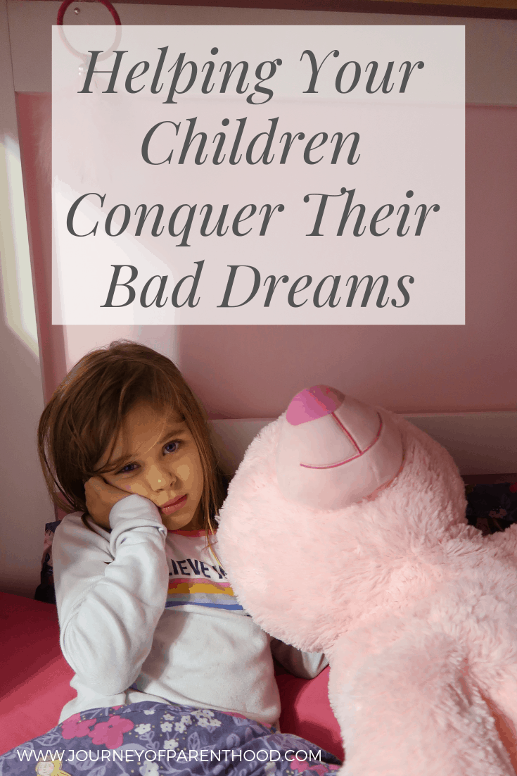 little girl laying on bed looking sad - helping your children conquer their bad dreams