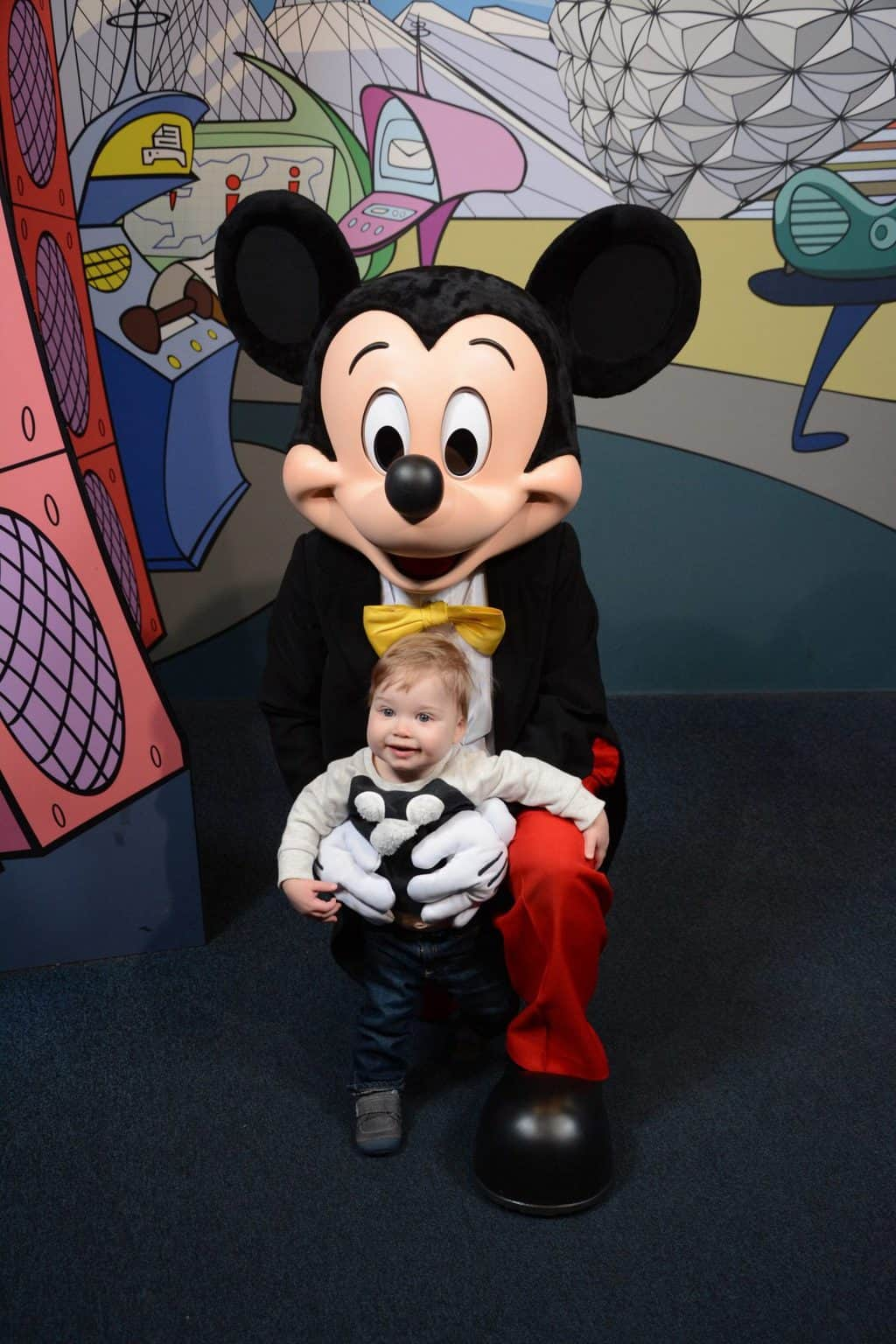 toddler with Mickey Mouse