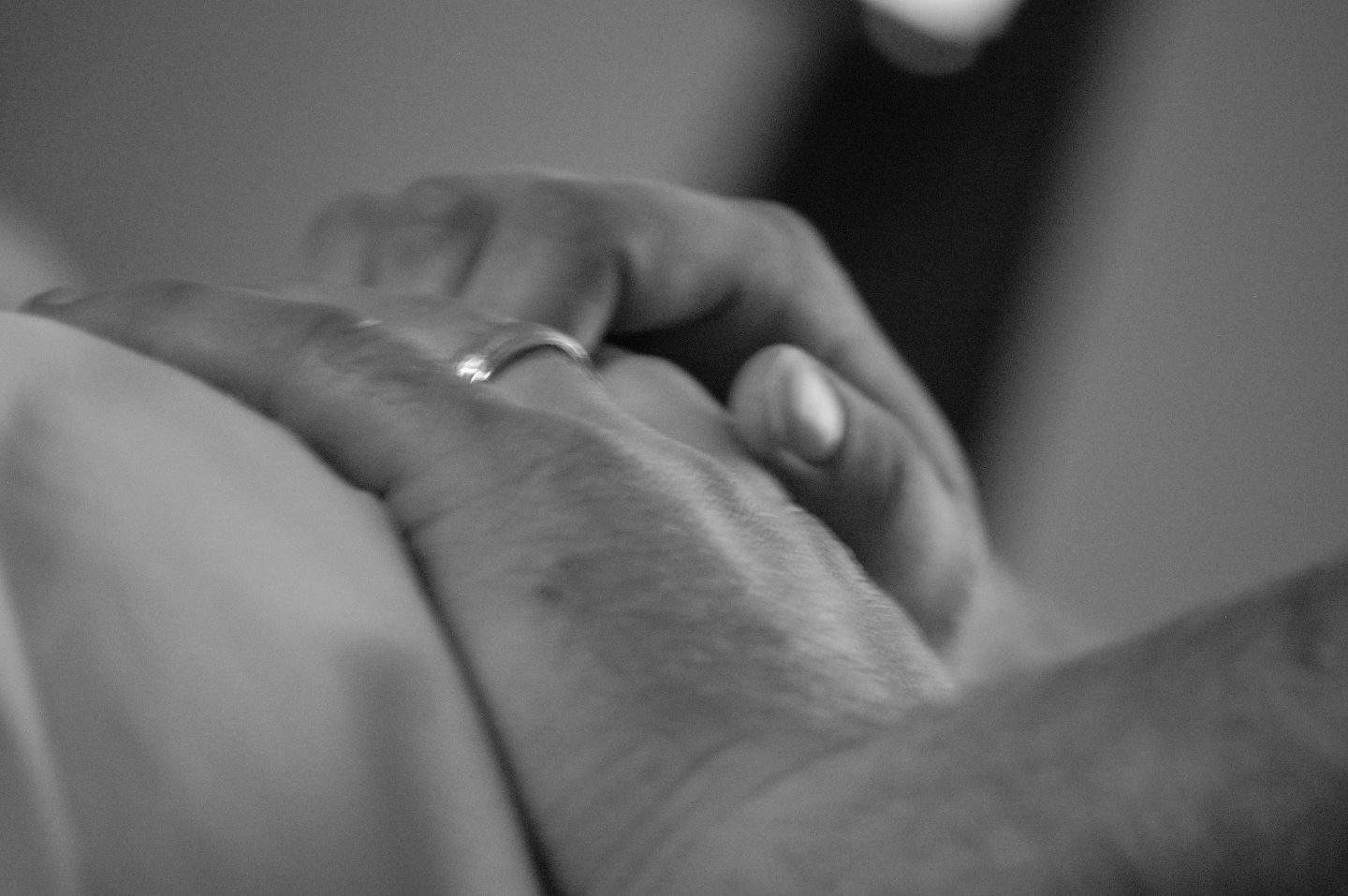husband and wife experience childbirth and holding hands