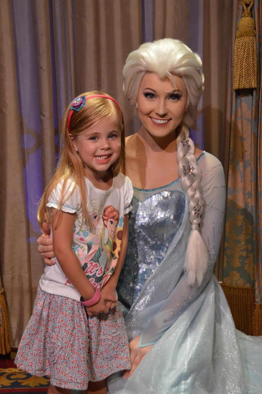 little girl with princess Elsa at Disney World