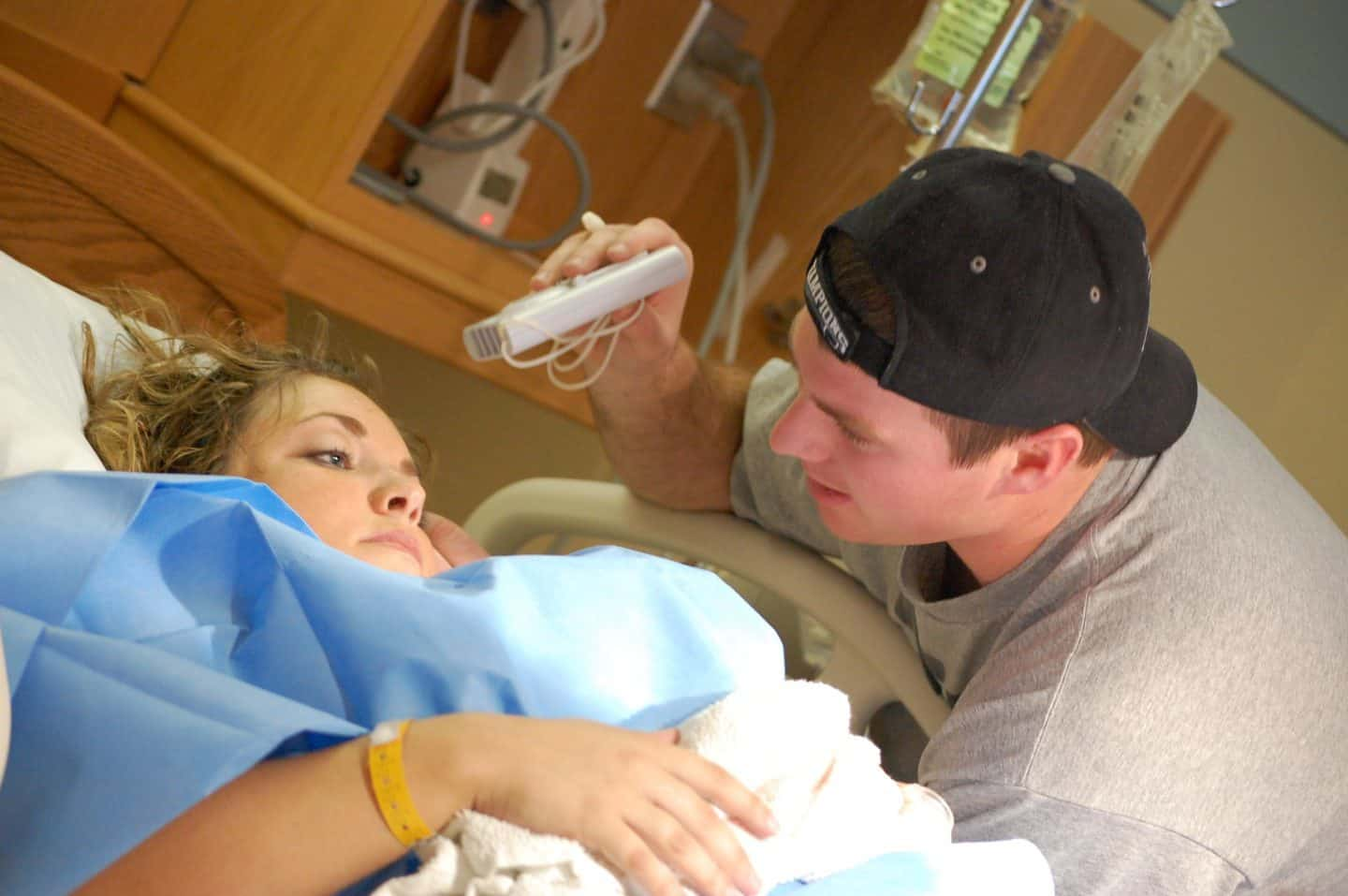 husband fanning wife during childbirth