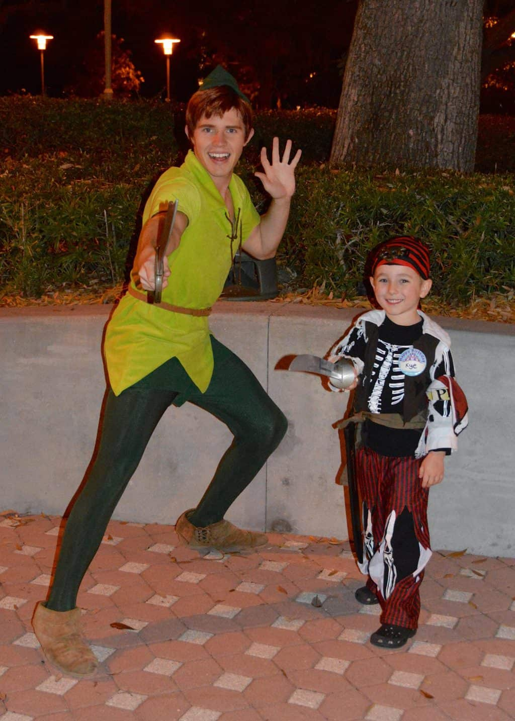 child in pirate costume with Peter Pan
