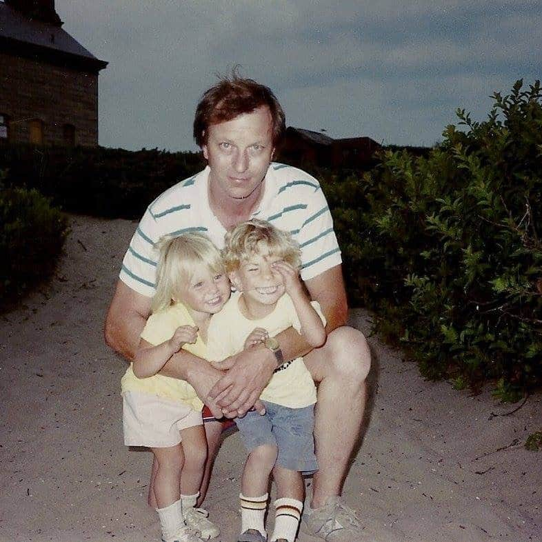 Caitlin as a child with her dad and brother