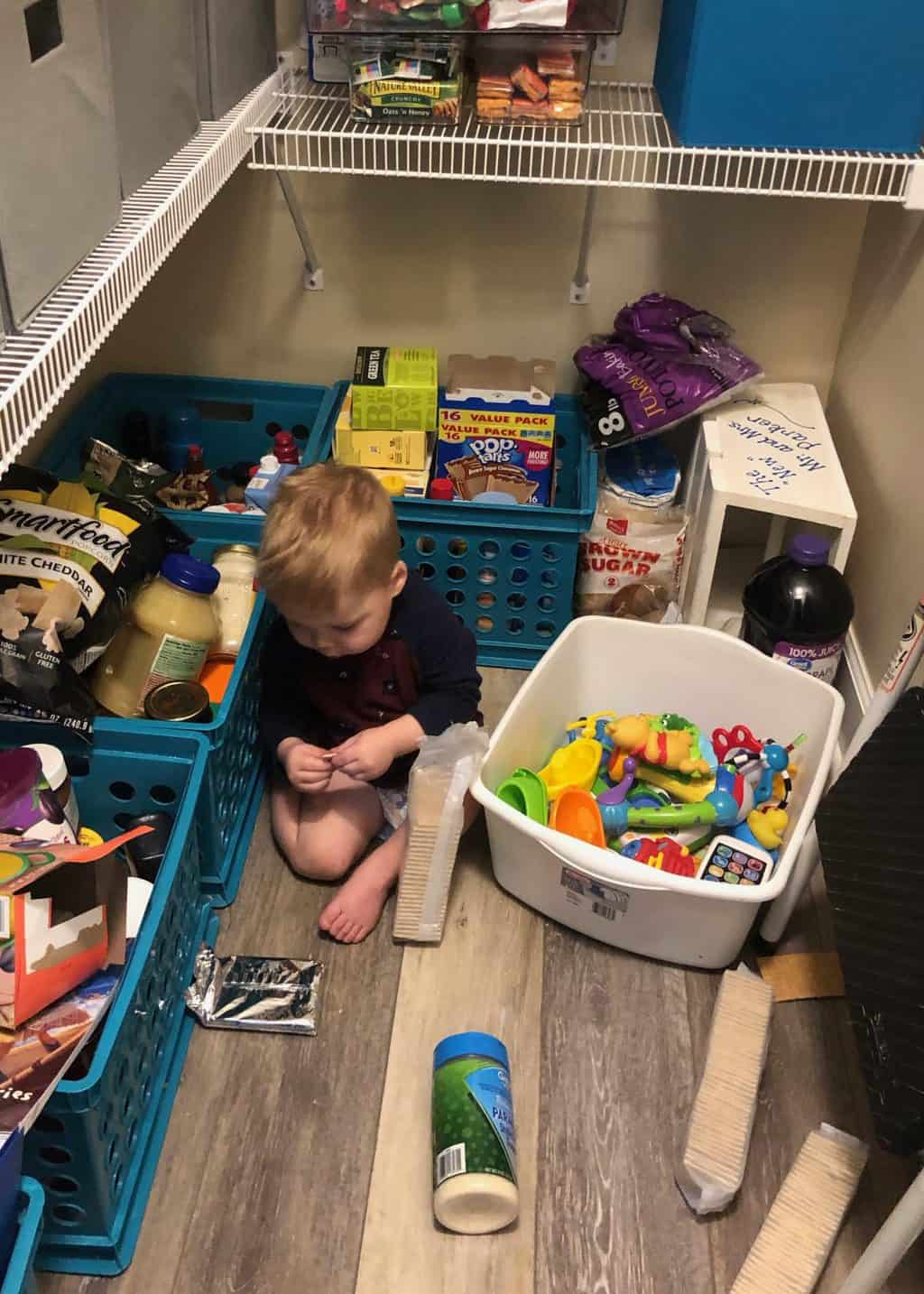 toddler in pantry