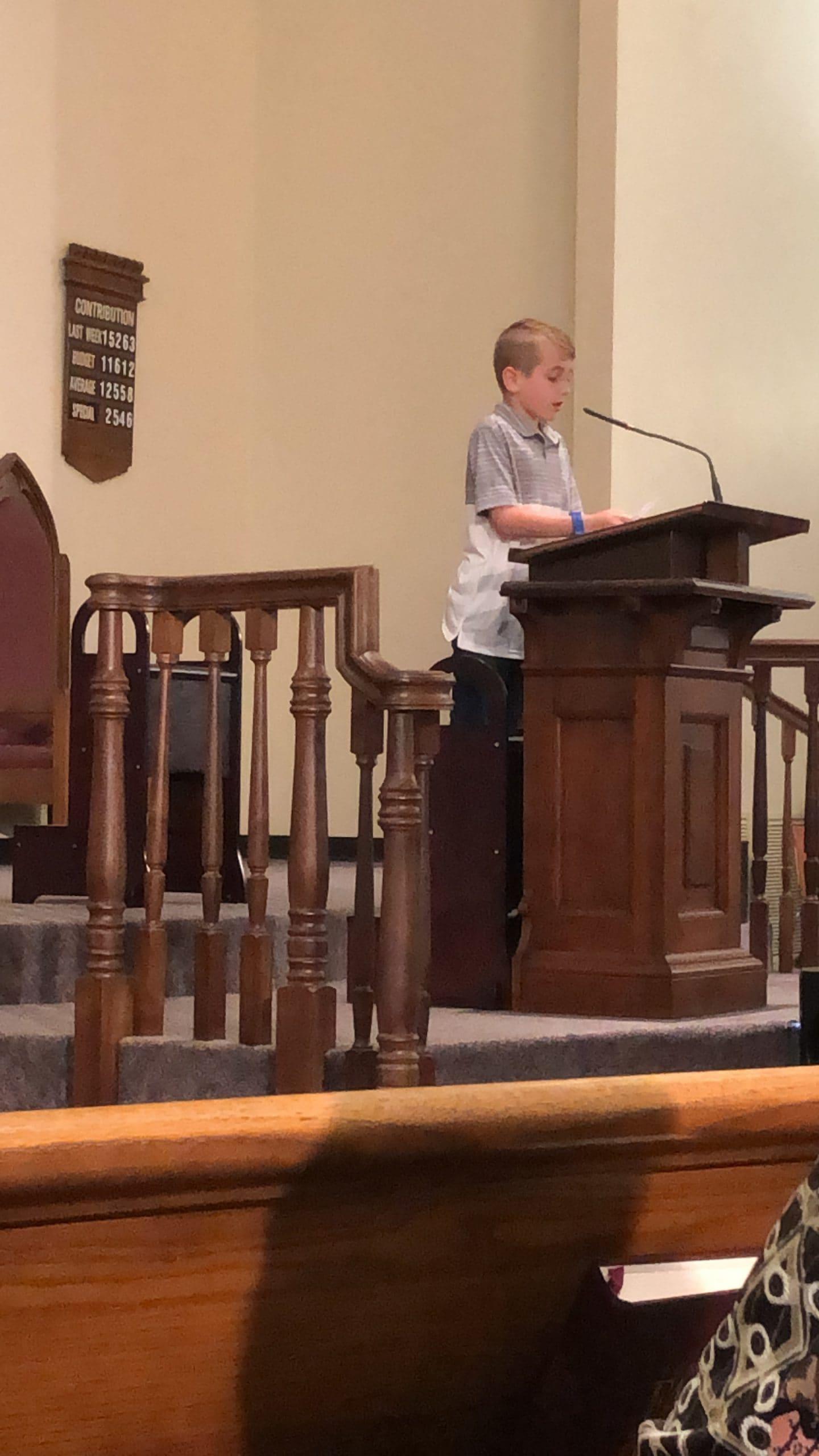 Kye speaking at church