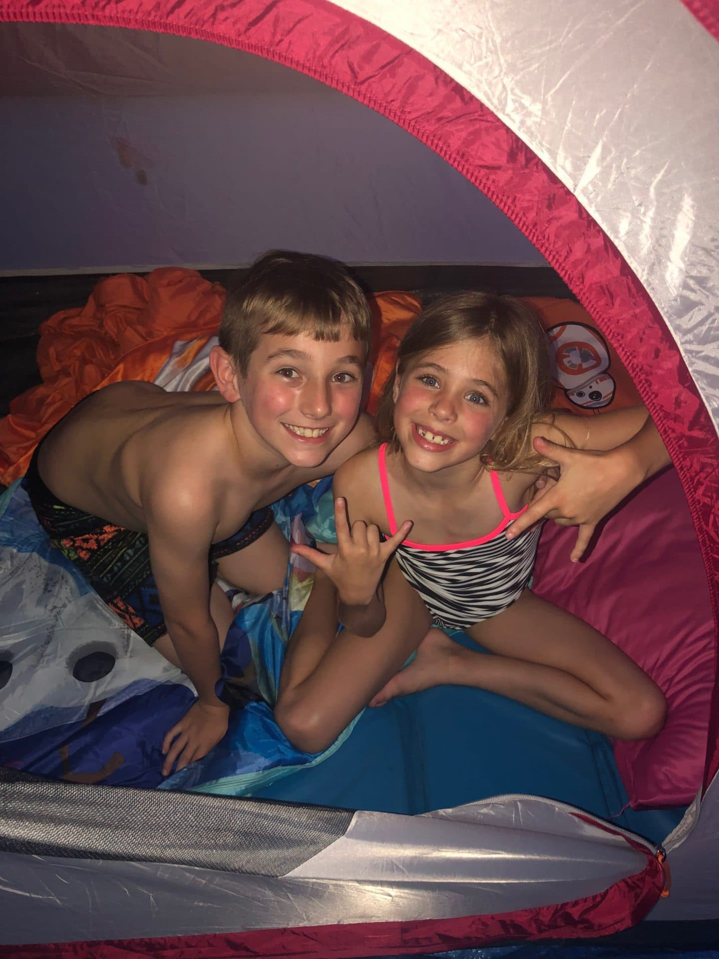 children camping and eating s'mores