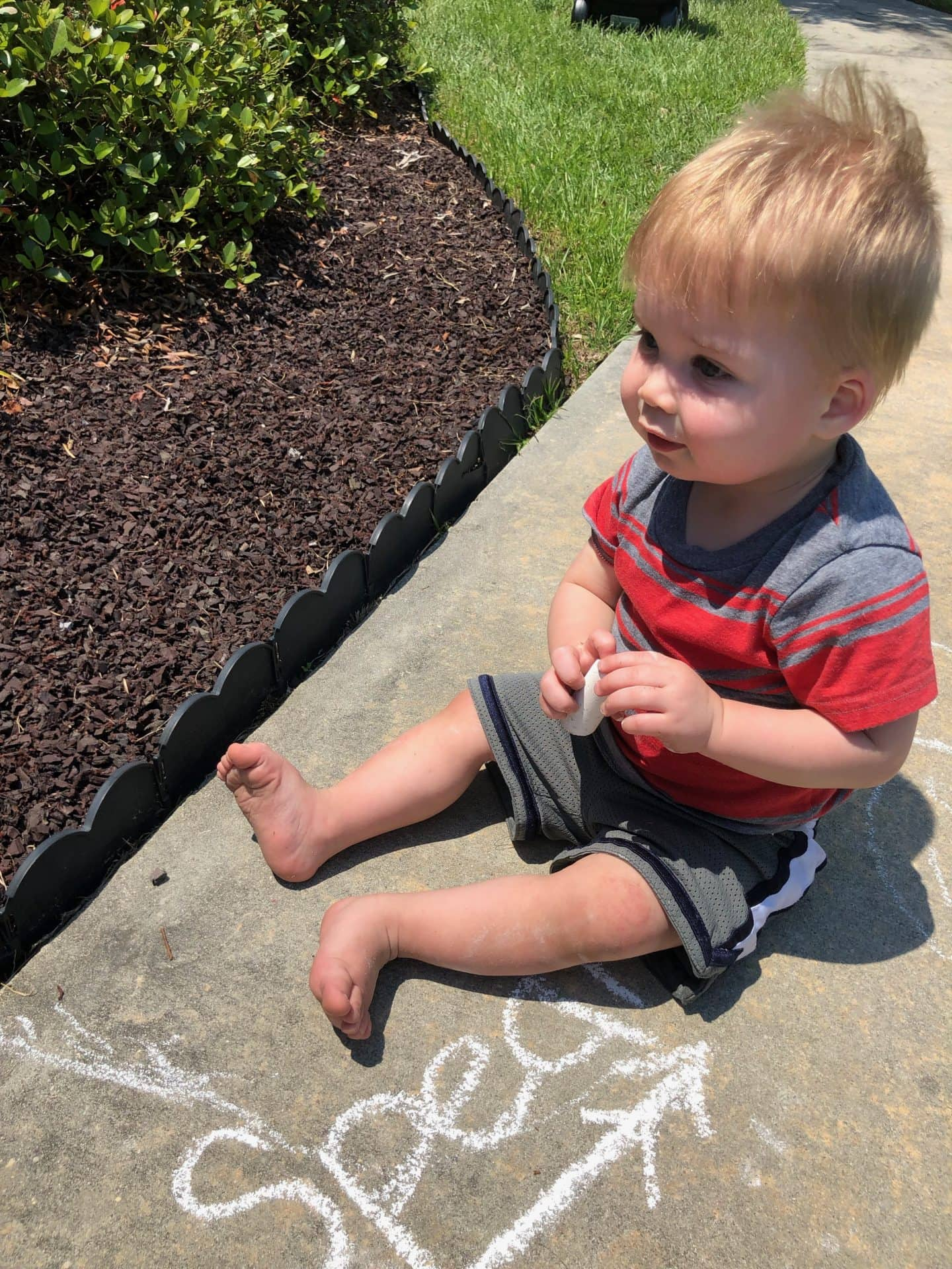 toddler drawing chalk