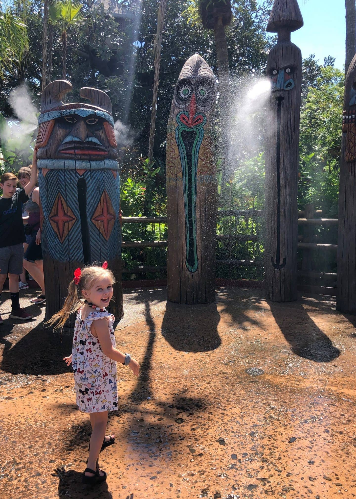 playing in water in Adventureland at magic kingdom