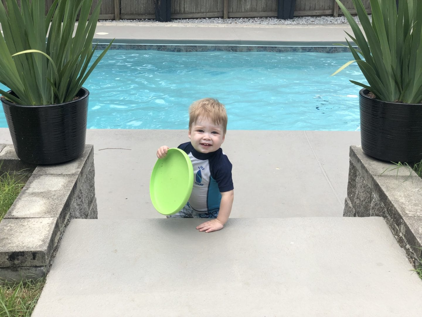 toddler boy in pool