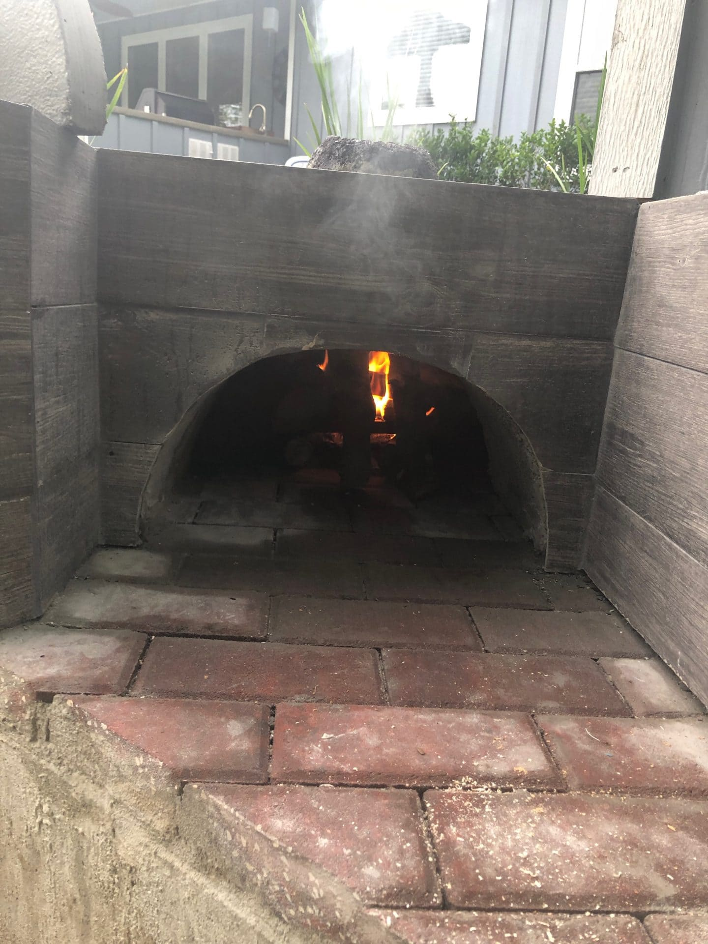 outdoor pizza oven and pool