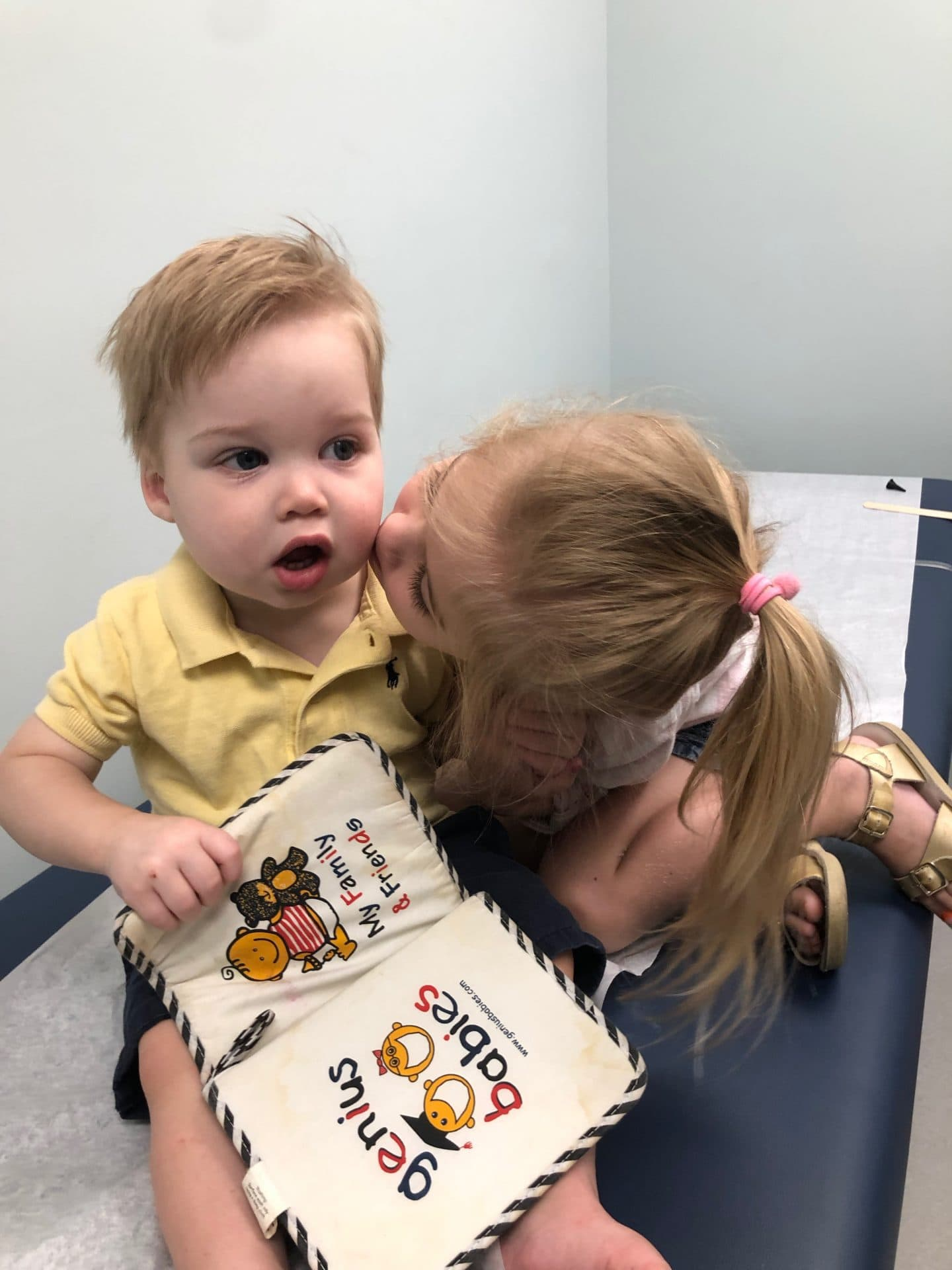 baby at dr visit with sister