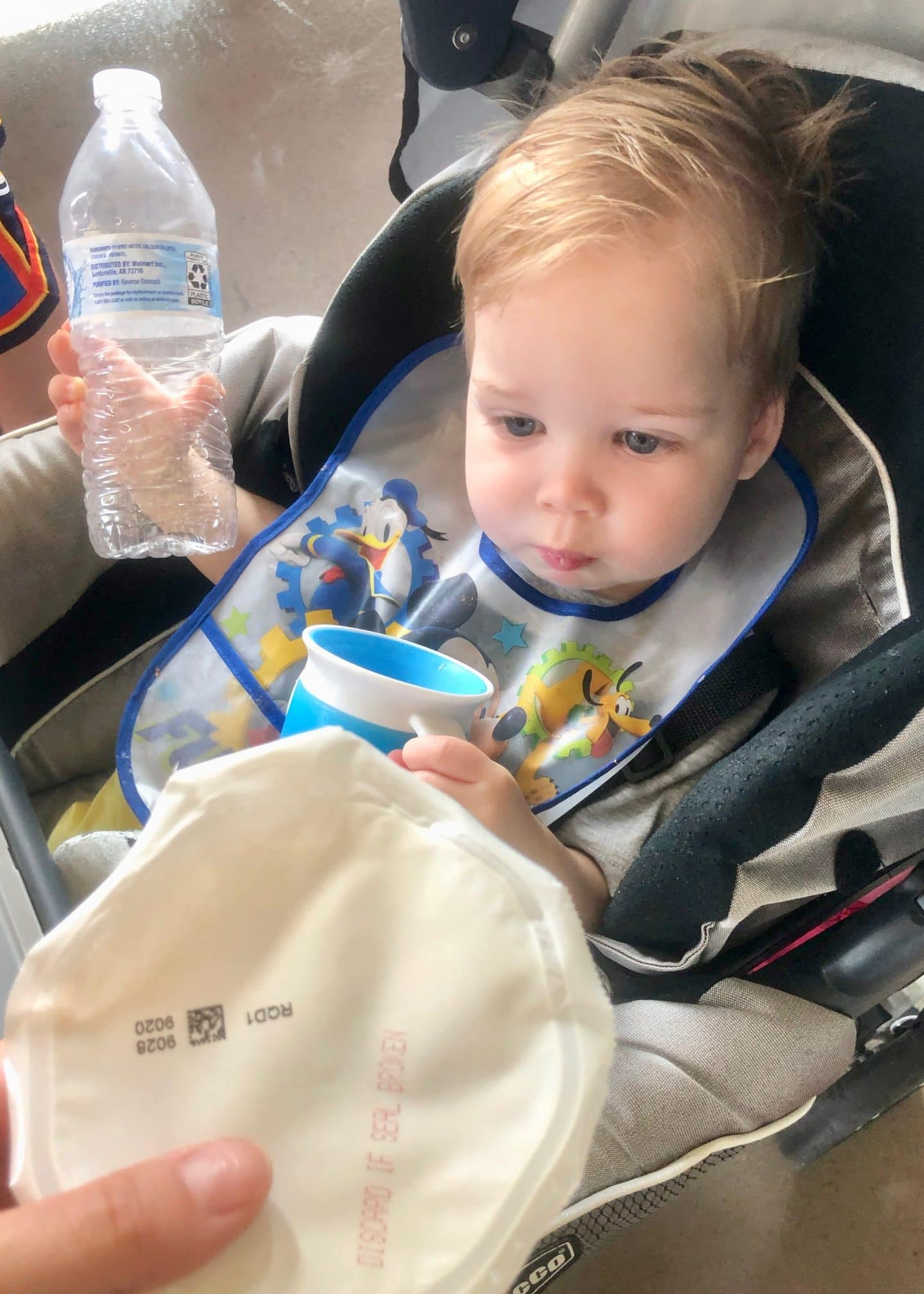 toddler eating breakfast in stroller at Disney World