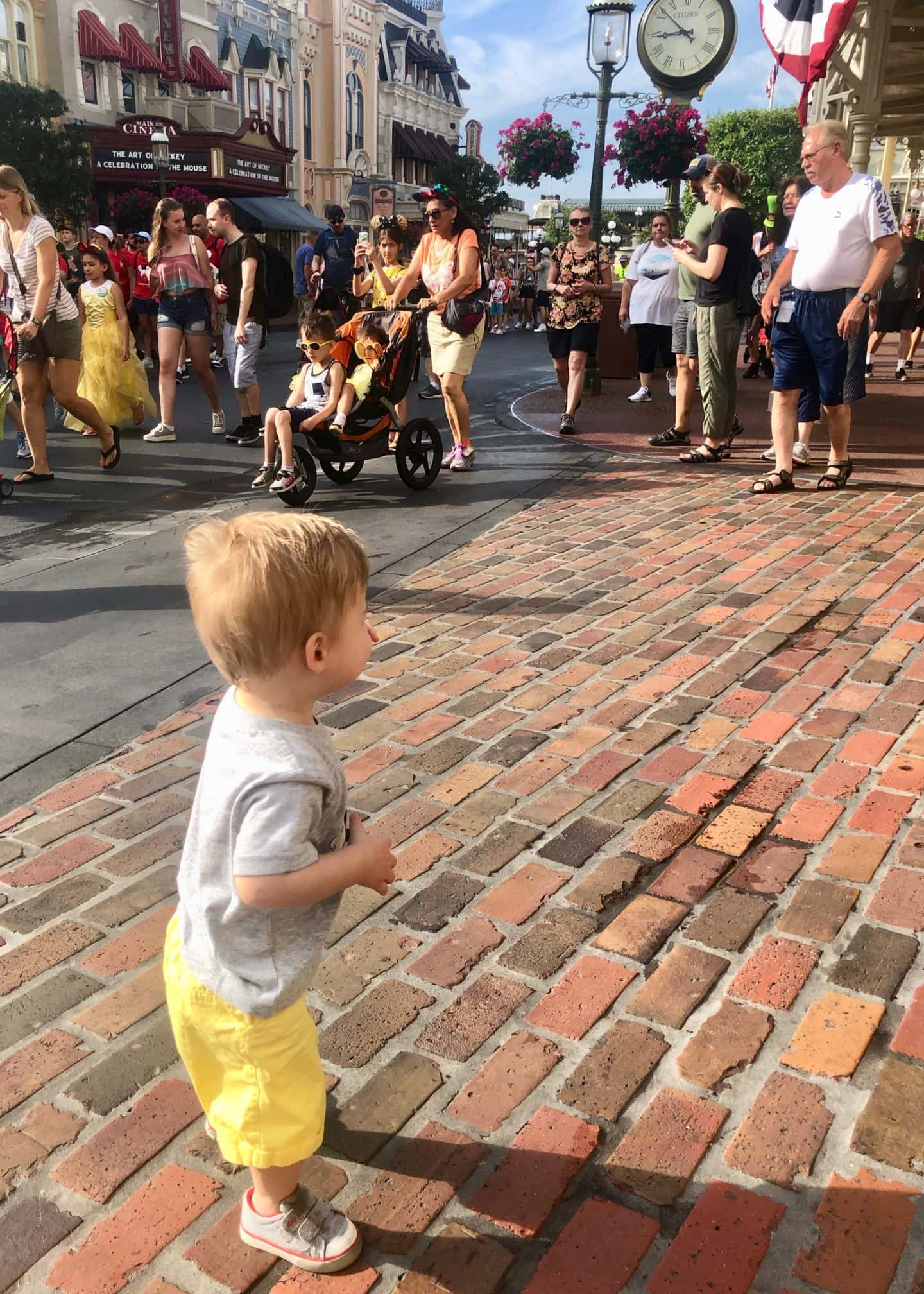 toddler boy walking down Main Street at magic kingdom Disney World