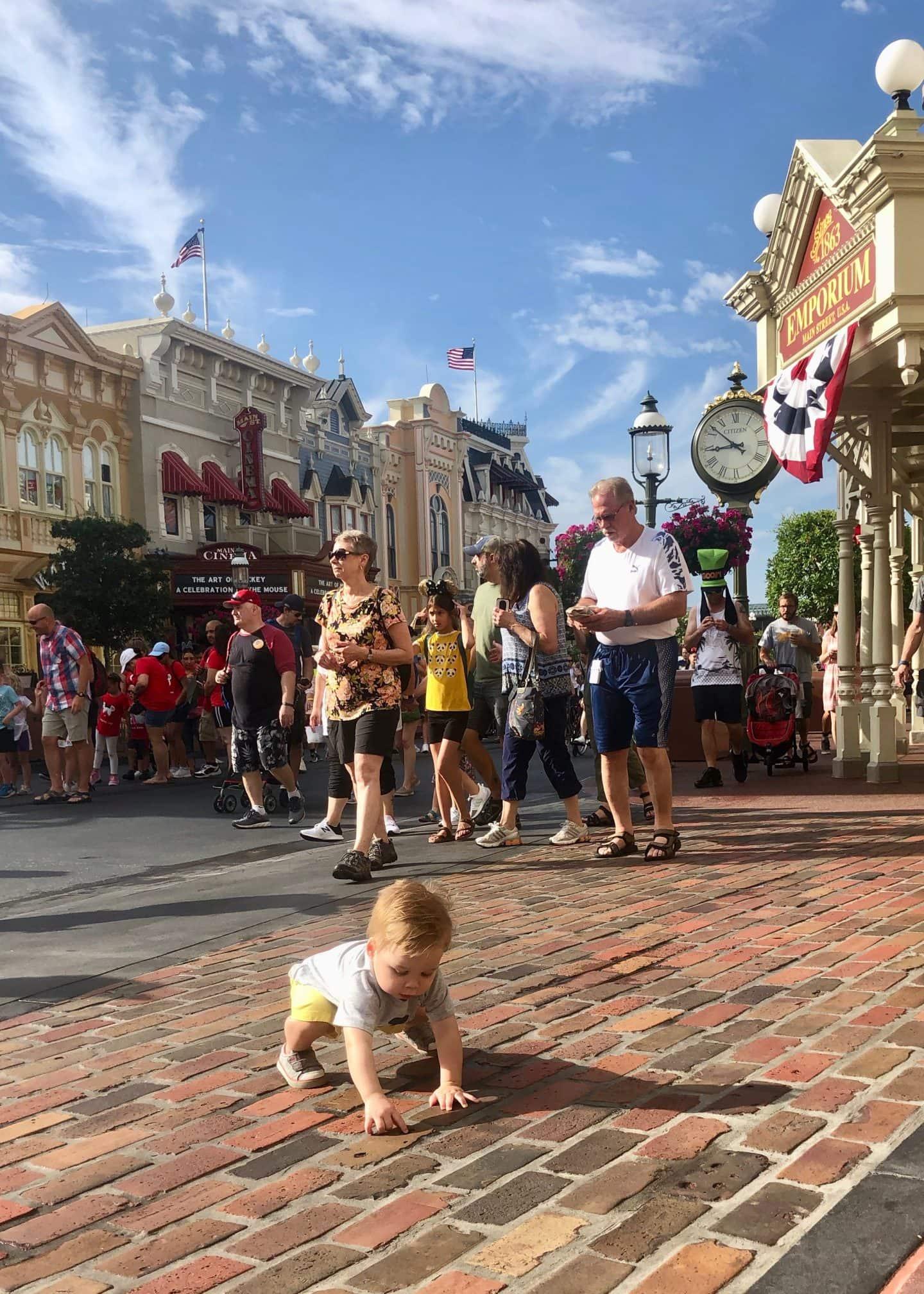 toddler boy walking down Main Street at magic kingdom Disney World