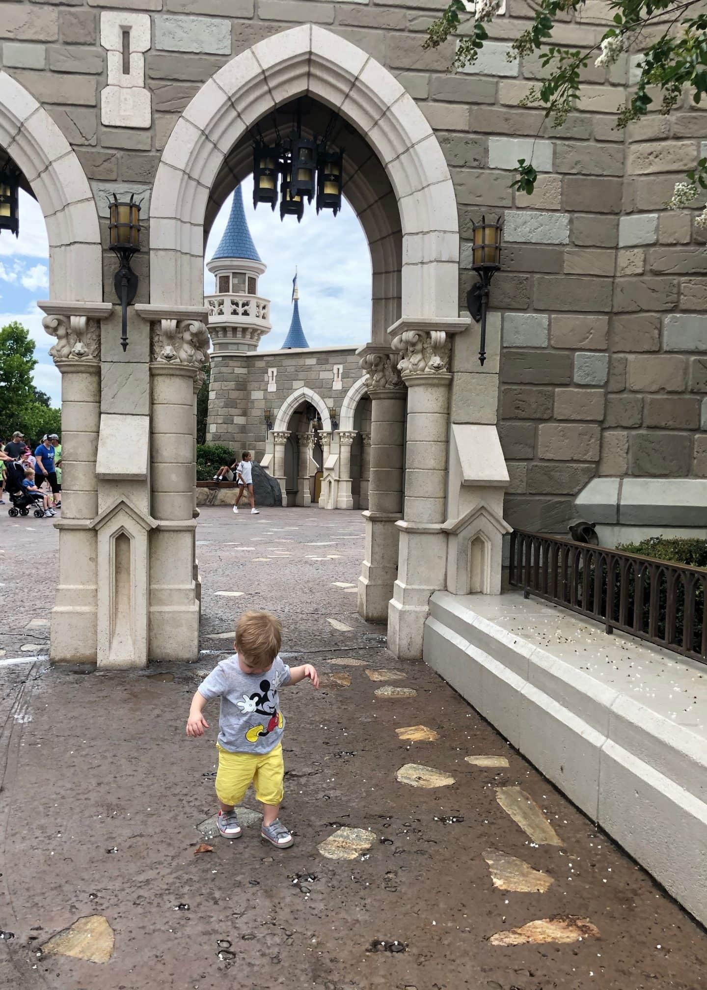 toddler boy exploring fantasyland at magic kingdom in Disney World
