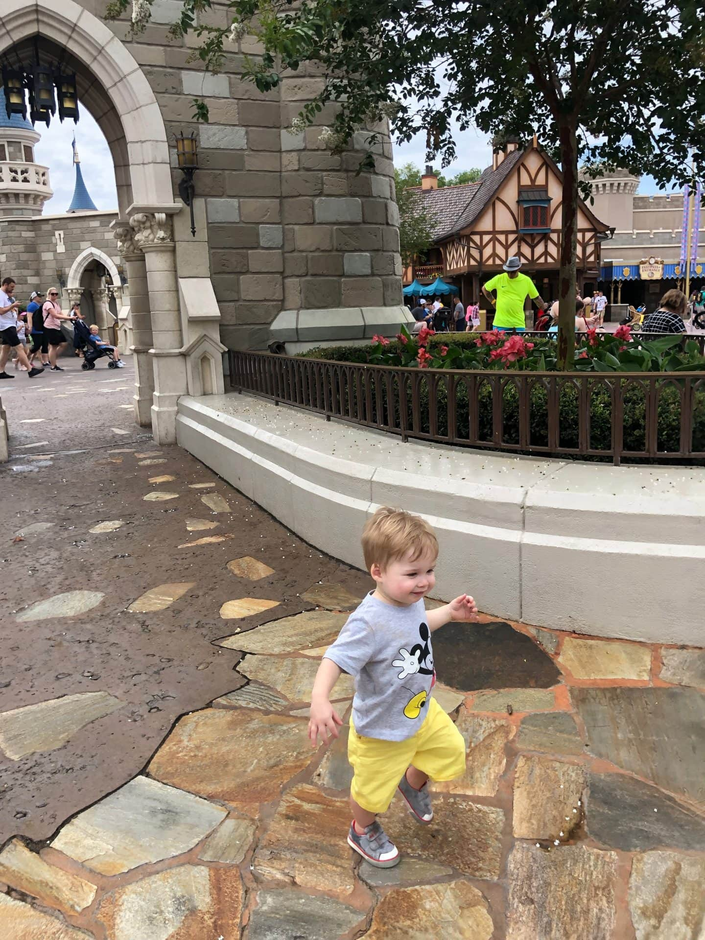 toddler boy exploring fantasyland at magic kingdom in Disney World