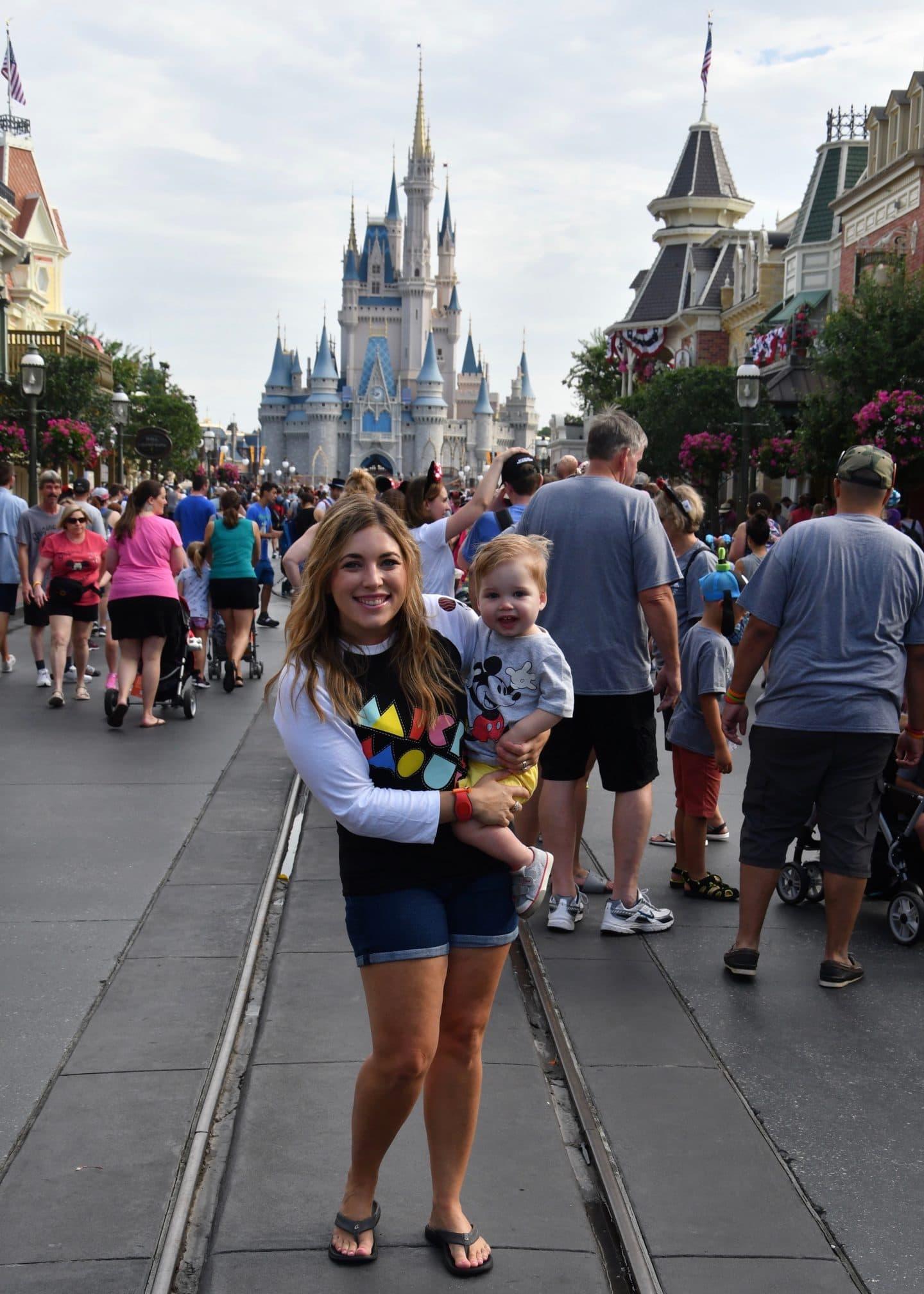 cinderella's castle magic kingdom with a toddler