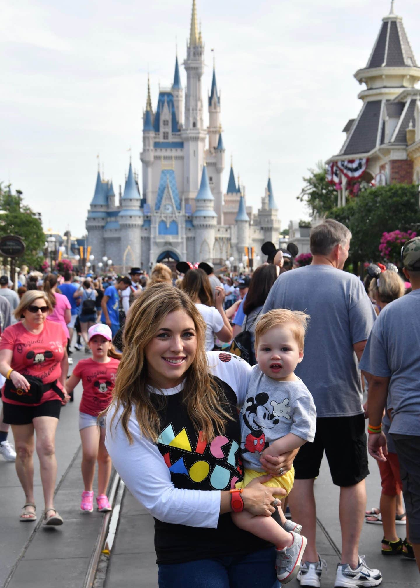 cinderella's castle magic kingdom with a toddler