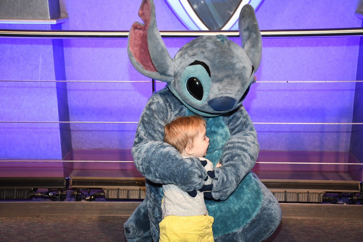 toddler boy meeting stitch at Disney World magic kingdom