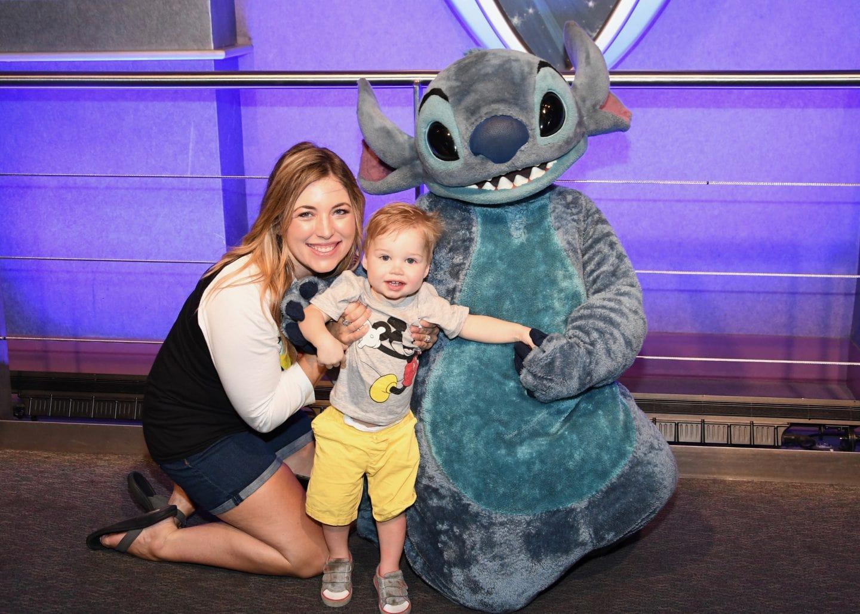 toddler boy meeting stitch at Disney World magic kingdom