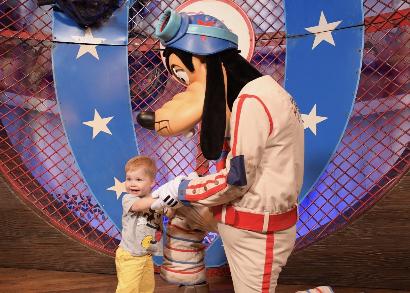 toddler boy with goofy at magic kingdom Disney World