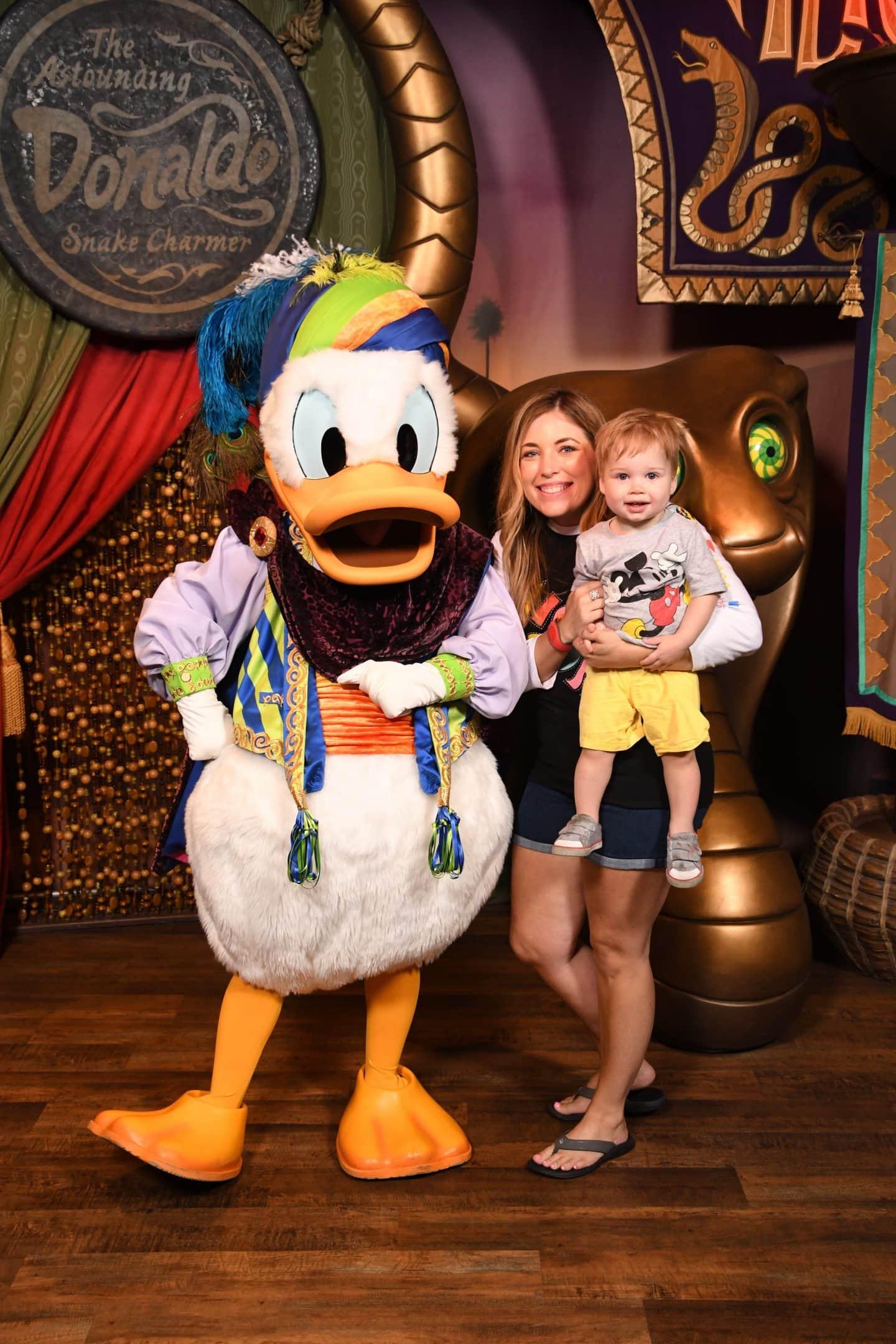 toddler boy meeting Donald Duck at magic kingdom Disney World