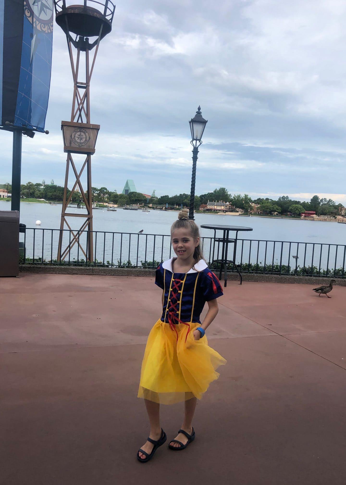 girls in princess dresses at Epcot