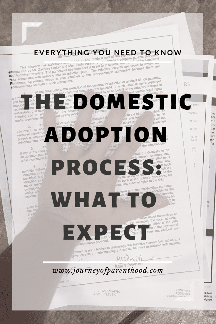 hand on adoption papers - the domestic adoption process what to expect