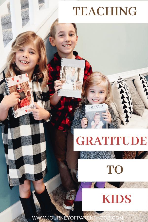 three kids holding a grateful journal - teaching appreciation in an entitled world