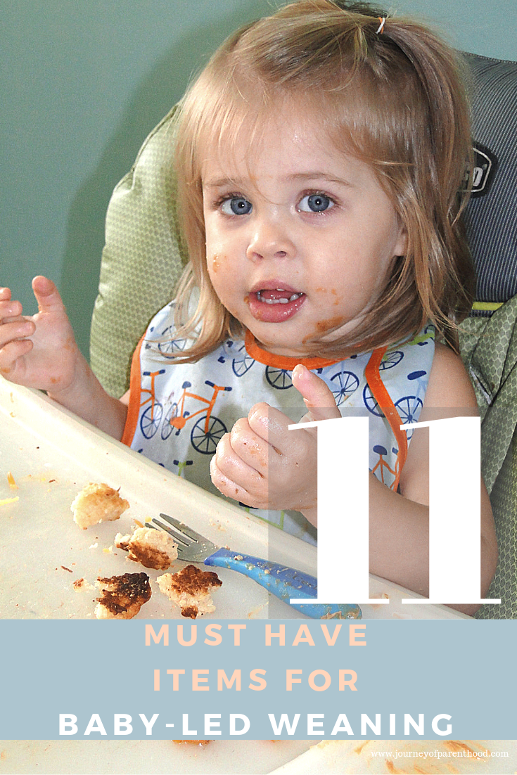 baby in high chair eating - 11 items for baby led weaning