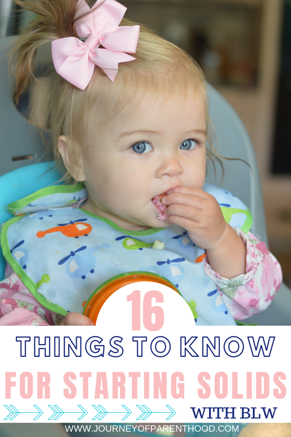 16 things to know for starting solids with baby led weaning - baby sitting in high chair eating