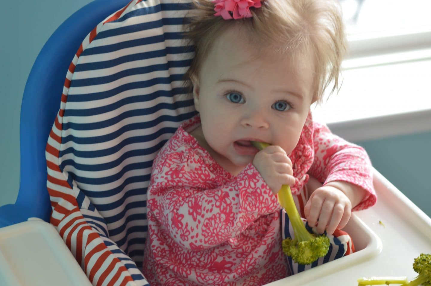simple guide to baby led weaning - third baby enjoying food in high chair