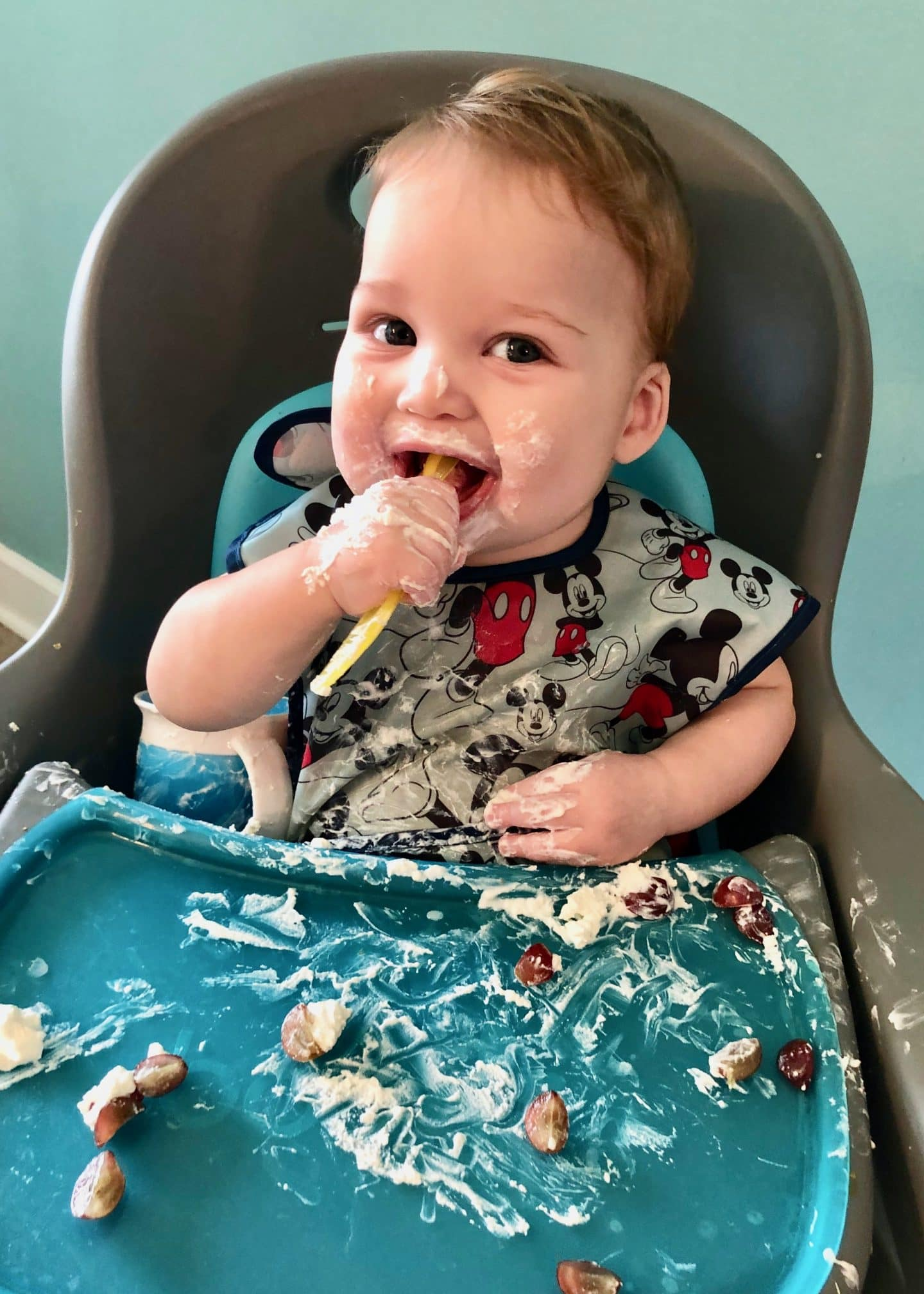 messy baby enjoying food using blw method