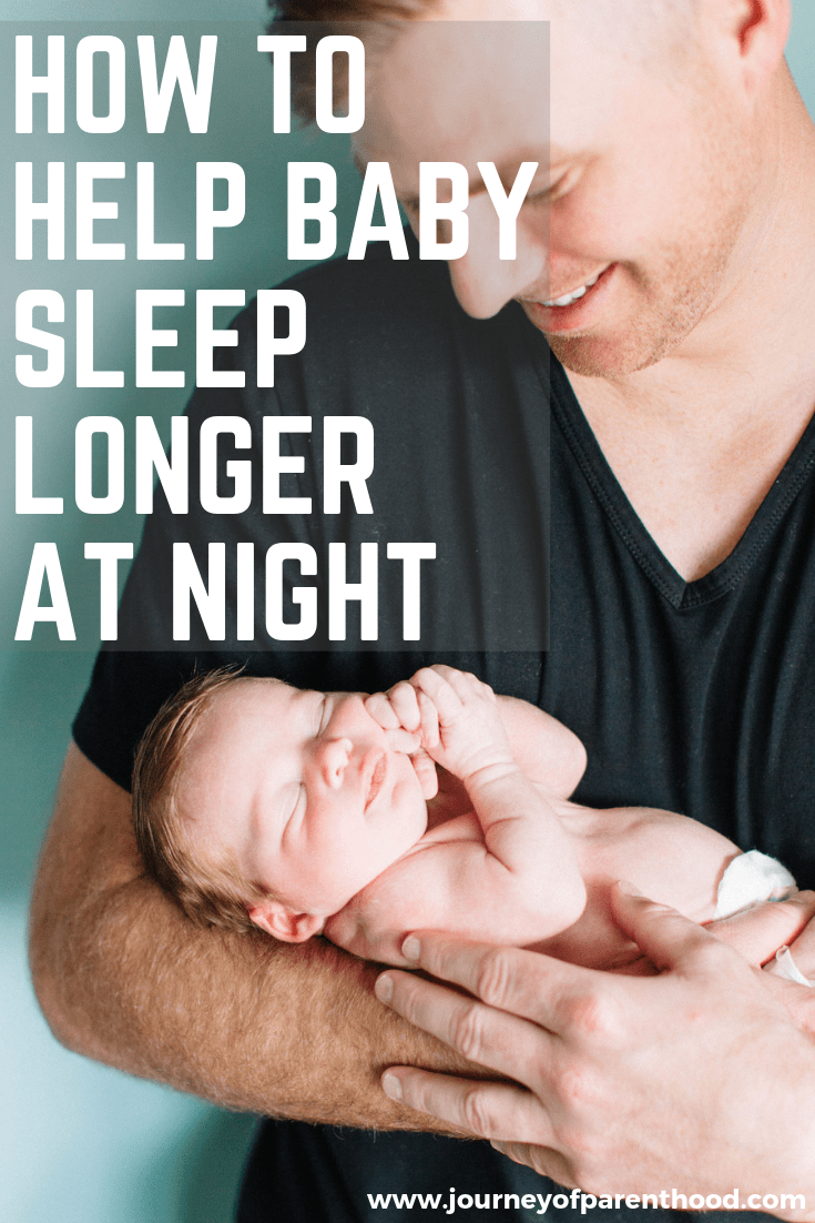 baby sleeping in dad's arms - how to help baby sleep longer at night