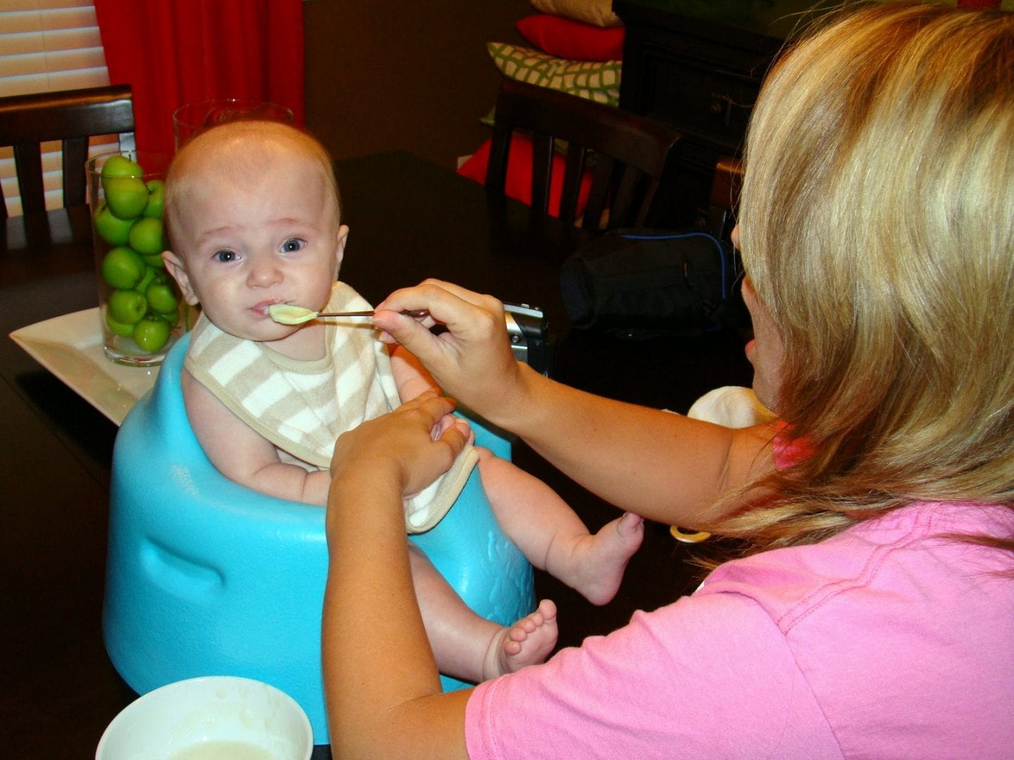baby spoon feeding before mom learned about baby led weaning method