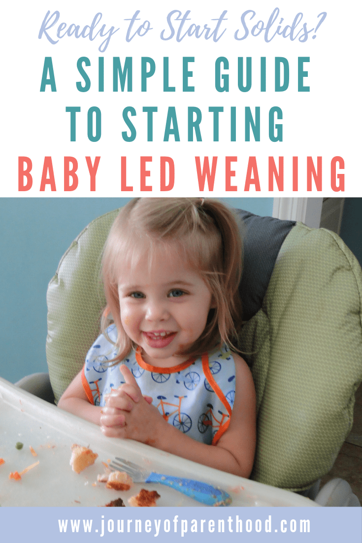 a simple guide to starting baby led weaning - baby sitting in high chair with solid food