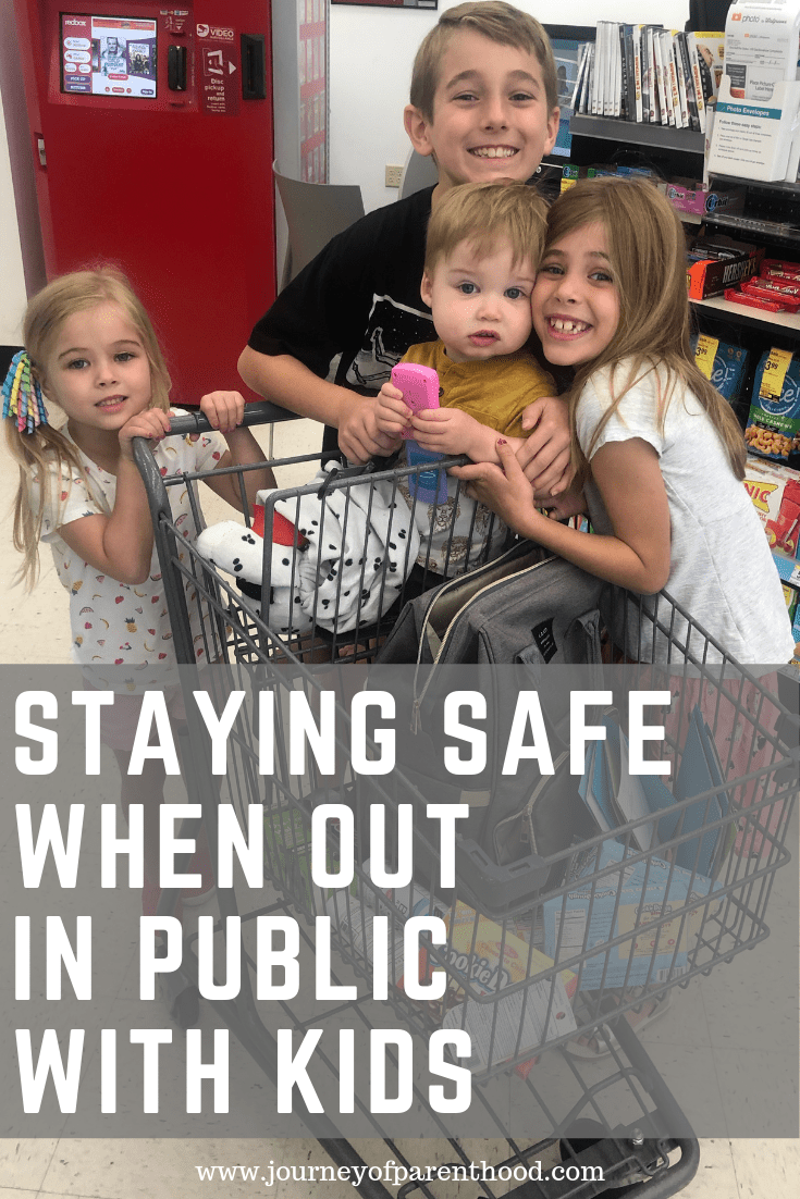 four children in shopping cart - staying safe when out in public with kids