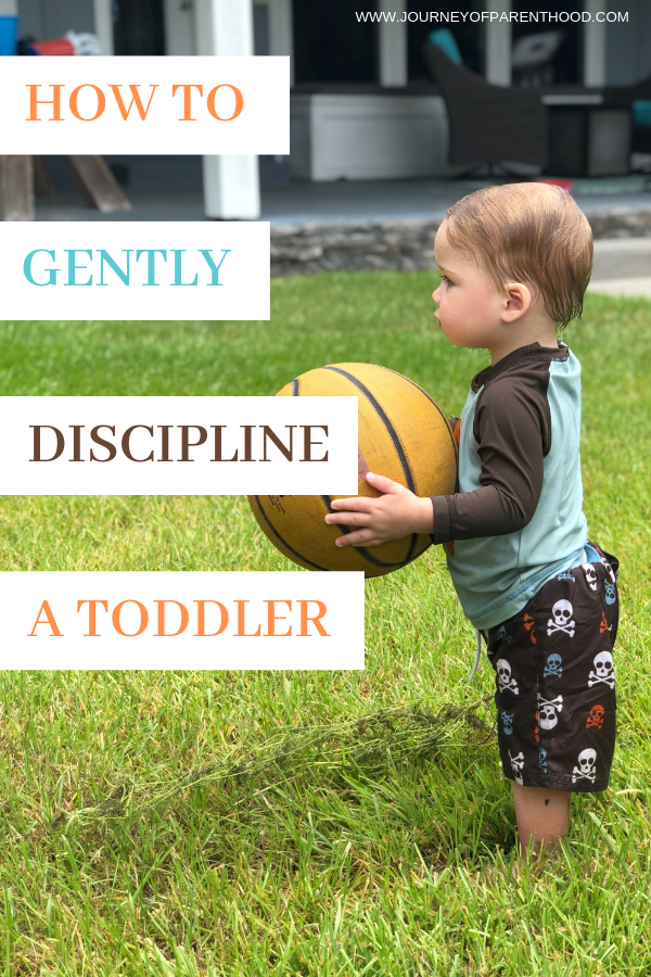 toddler boy holding basketball - text reads how to gently discipline a toddler.
