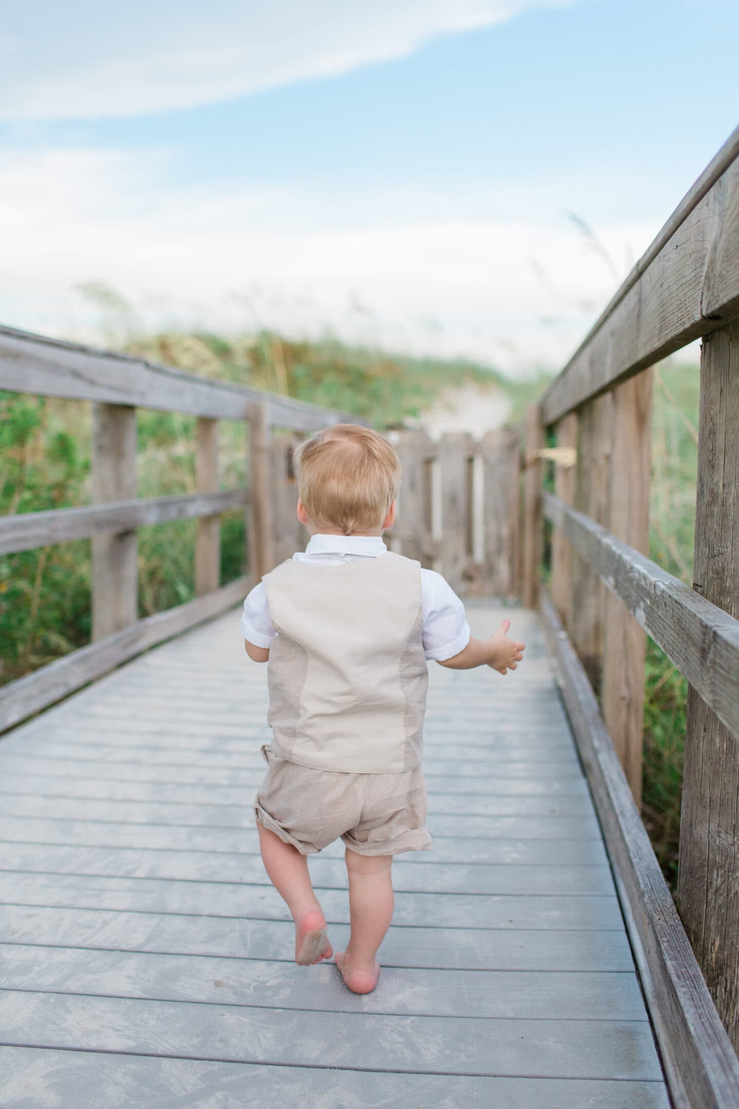 boy on beach by captured by Colson