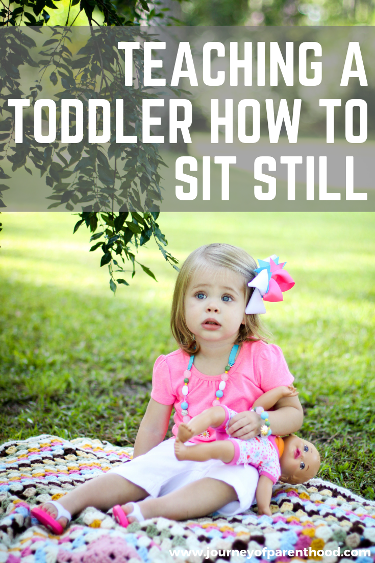 toddler sitting on blanket - teaching a toddler how to sit still