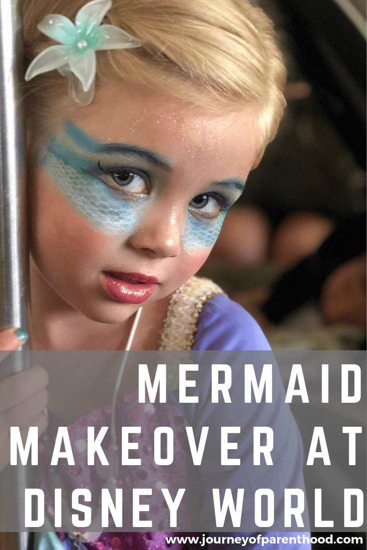 little girl at disney world with mermaid makeover from the pirate's league
