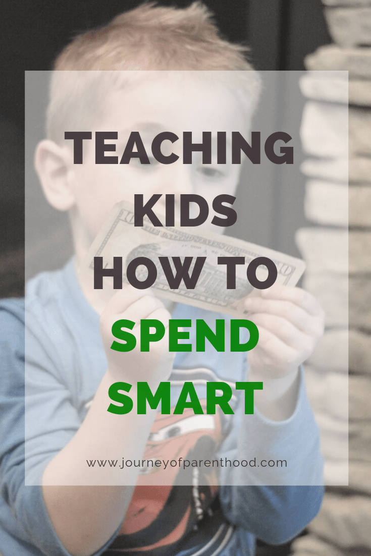 boy with money - teaching kids how to spend smart