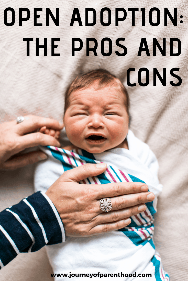 baby being comforted - open adoption the pros and cons