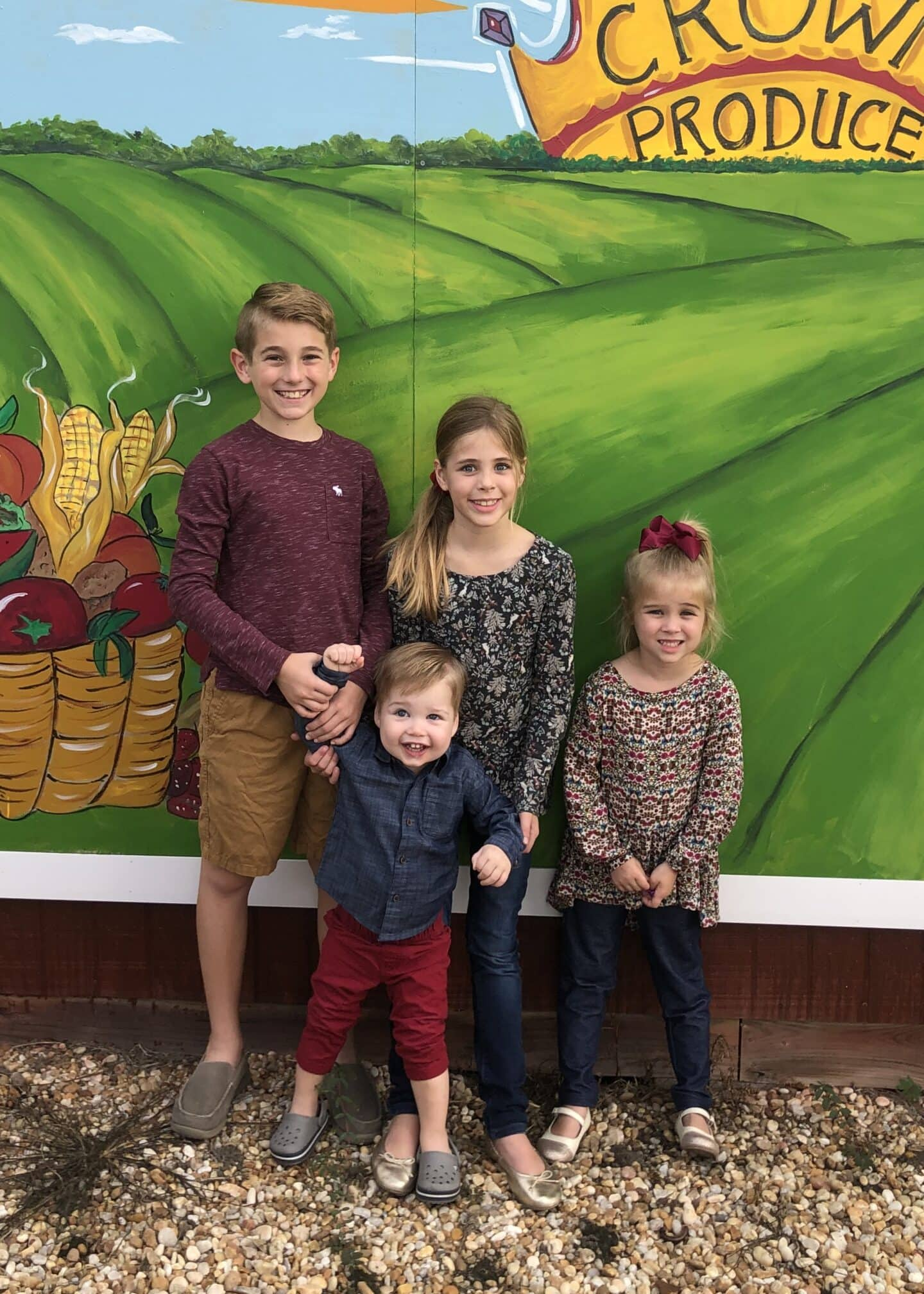 four kids against wall biological and adoptive child