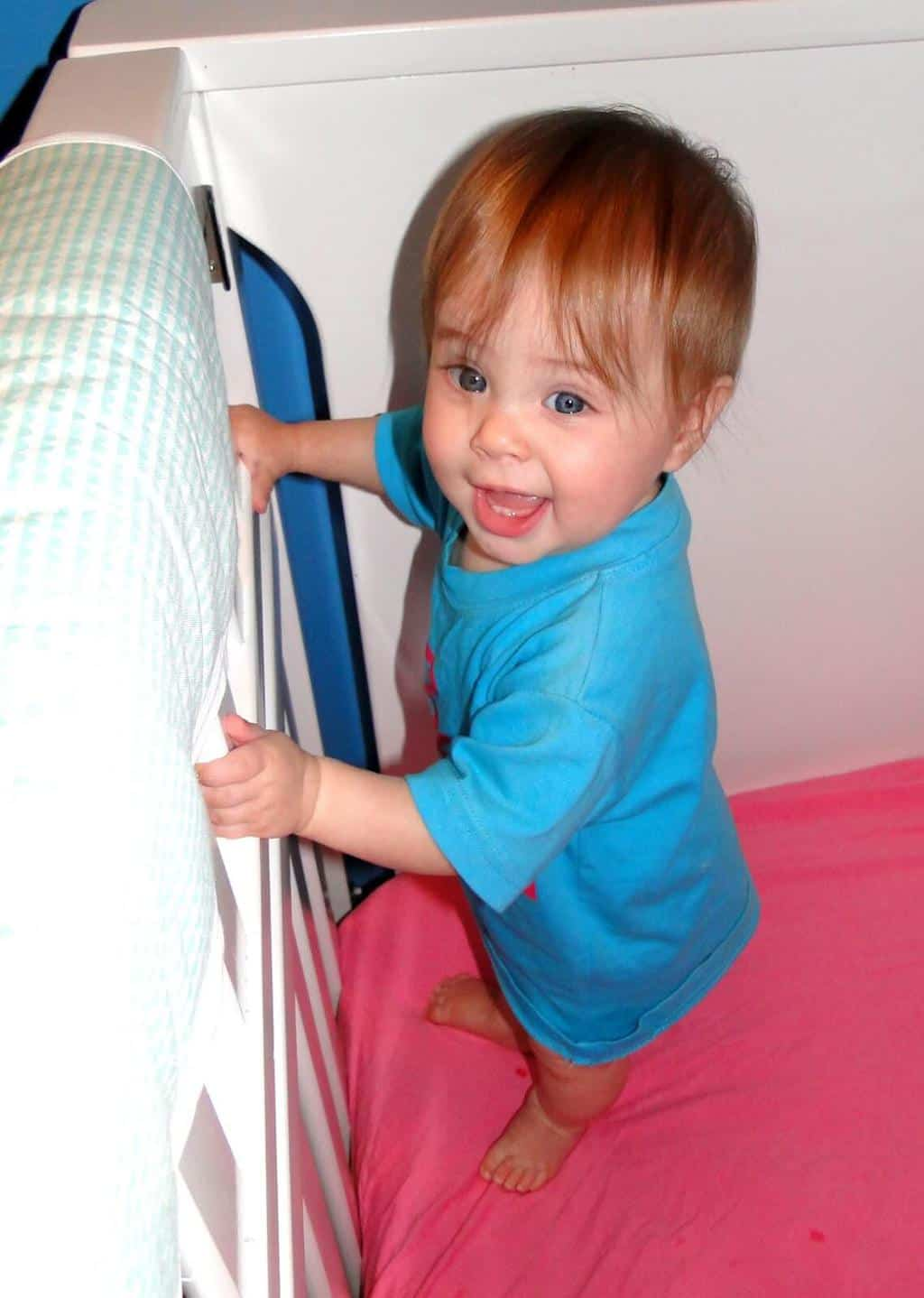 When To Drop the evening catnap With Babywise techniques - baby standing in crib