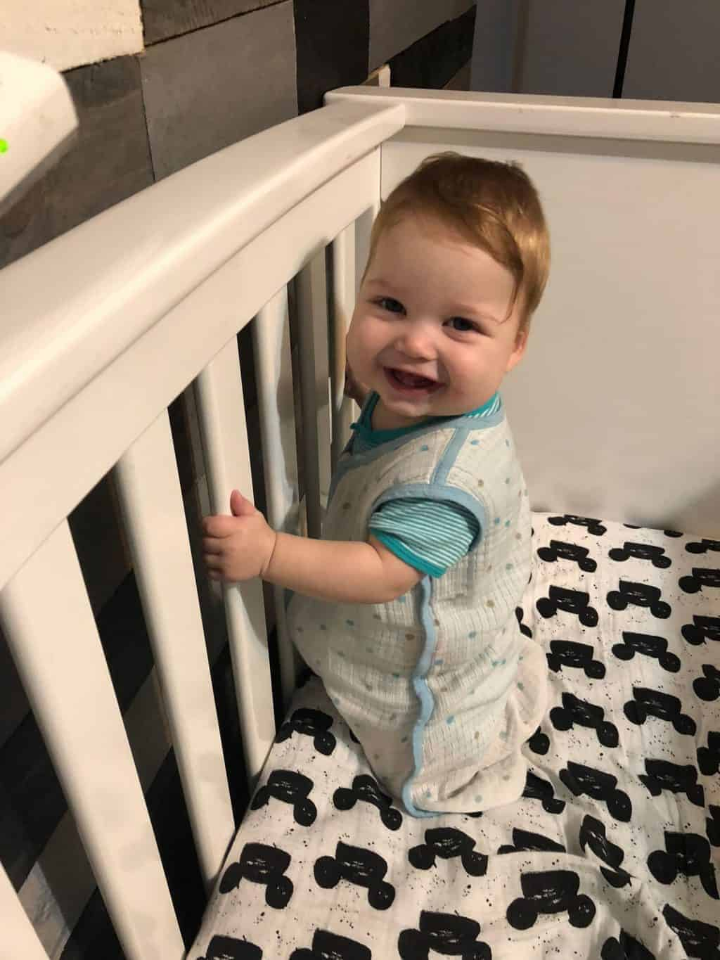 how To Drop the 3rd Nap With Babywise - baby standing in crib