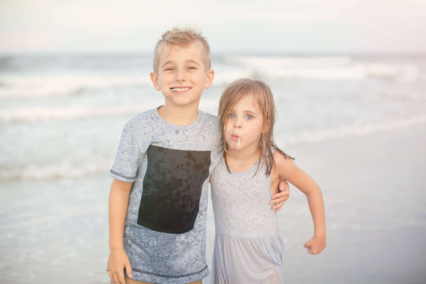 siblings at the beach during a family beach photography session