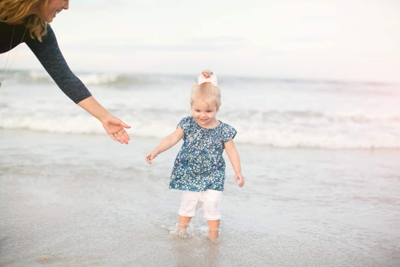 little girl walking in the ocean water
