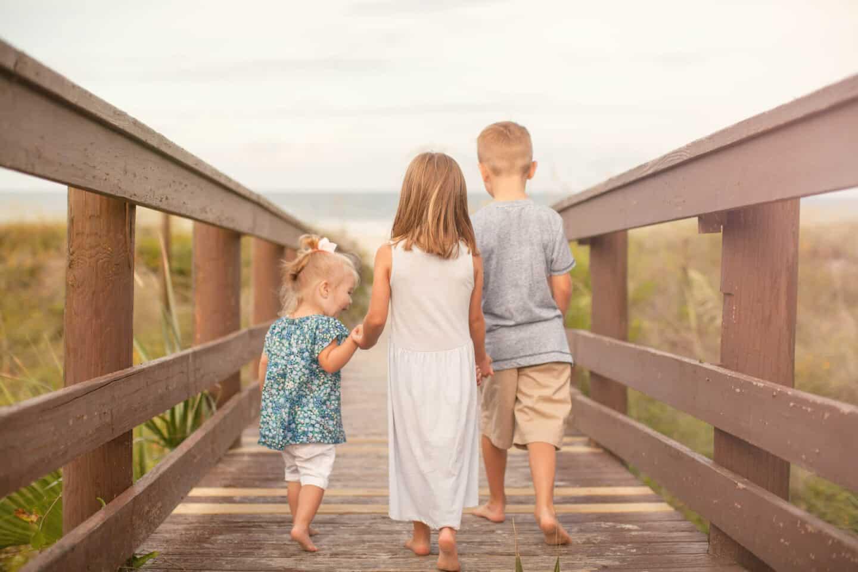 kids walking down boardwalk at the beach